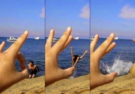 Flipping off guy in the Sea optical illusion
